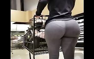 Sexy girl at supermarket with her big booty