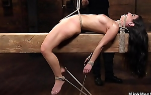 Hot petite brunette in hogtie caned