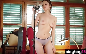 Singer sensual striptease in front of the microphone