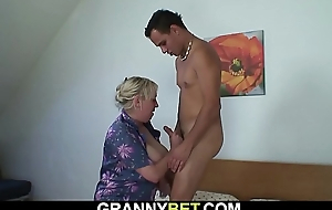 Big tits granny spreads legs for young dude